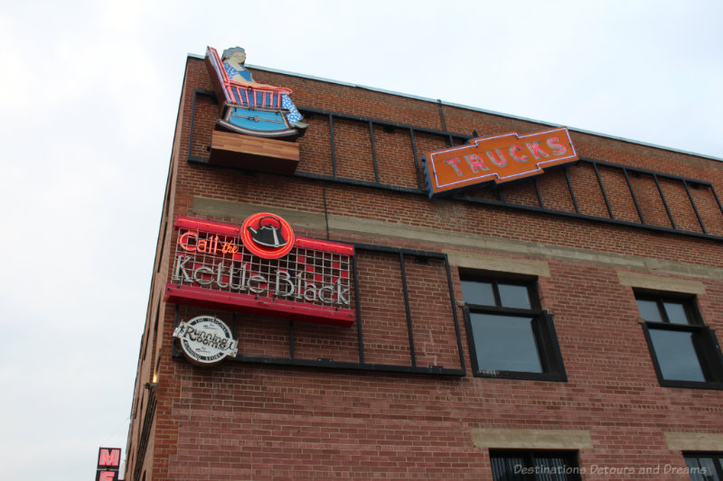 Neon signs on the red brick Mercer Building at the Edmonton Neon Museum