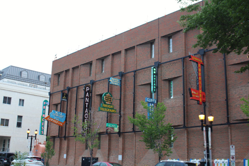 Neon signs attached to a brick wall as part of the Edmonton Neon Museum