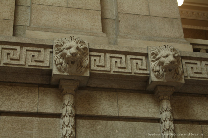 Stone lions on the wall of the Manitoba Legislative Building