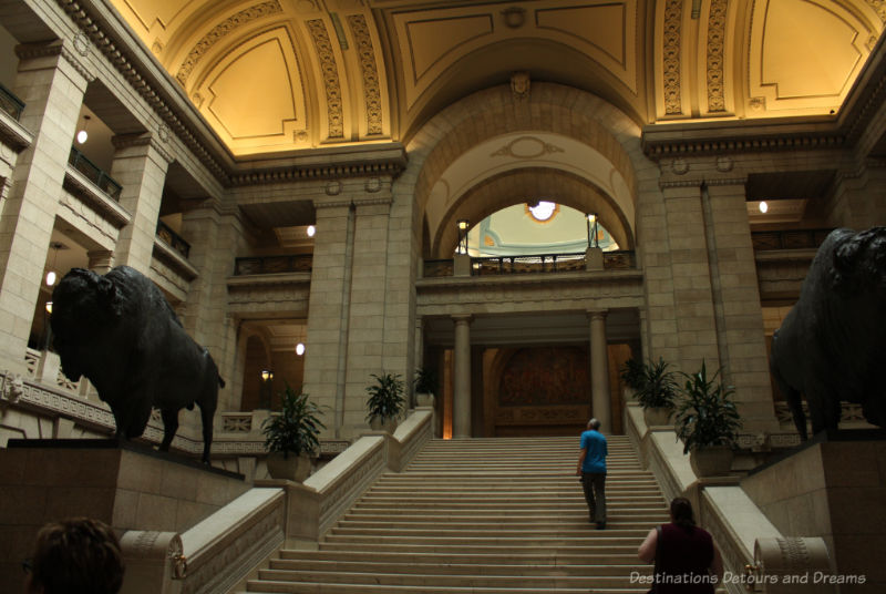 Bison on either side of the Tyndall stone Grand Staircase at the Manitoba Legislative Building