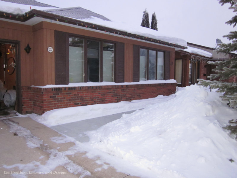 Homeward bound - snow in front of home with cleared sidewalk