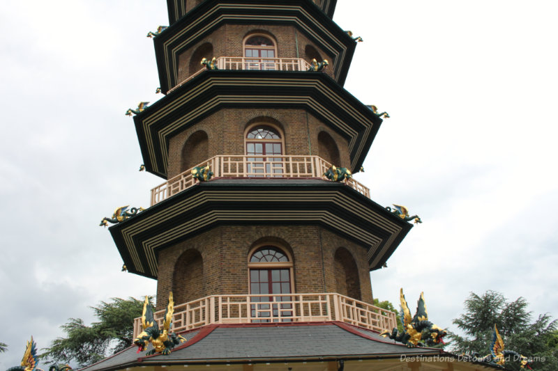 Part of the tower of the pagoda at Kew Gardens with dragons decorating it