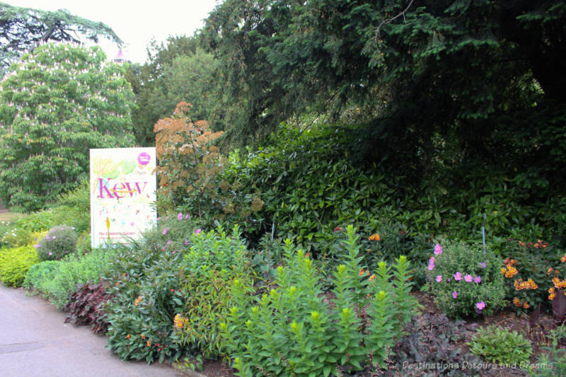 Flowers and trees at one of the entrances to Kew Gardens in London