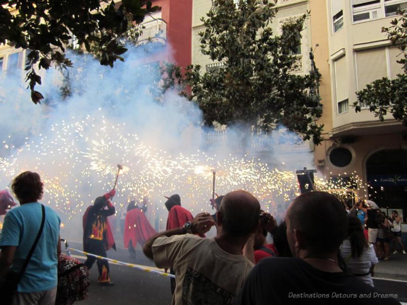 Correfoc (fire run) at Gracia Street Festival parade