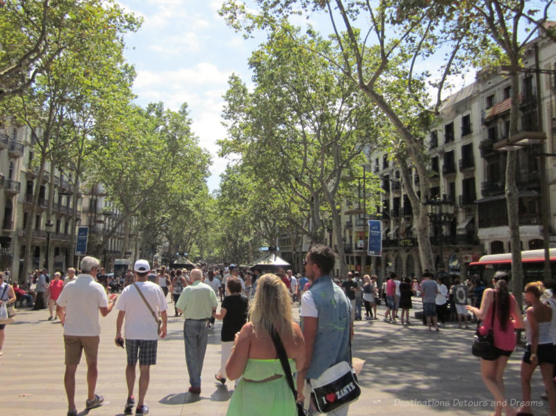 People walking down the Las Rambla broad promenade in Barcelona
