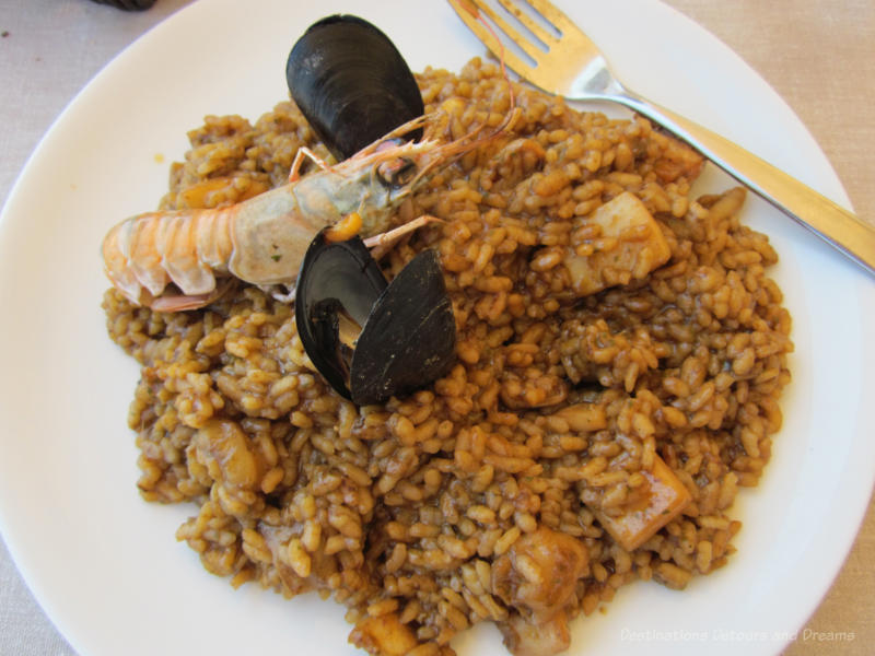 Plate of paella with shrimp and mussels