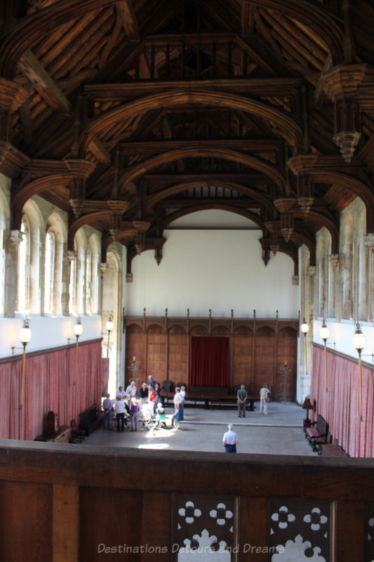 Medieval great hall with dark wood beamed ceiling at Eltham Palace