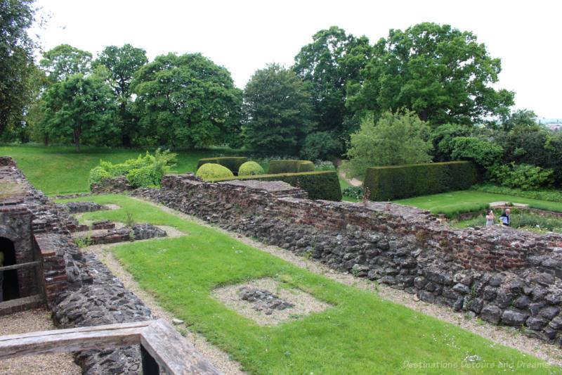 Stone ruins amid green gardens at Eltham Palace