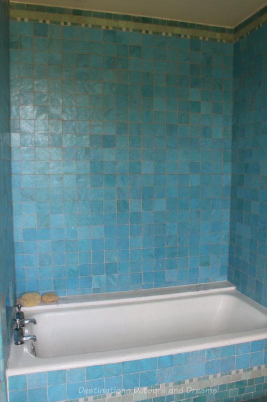 Bathtub surrounded by turquoise-coloured tiles at Eltham Palace