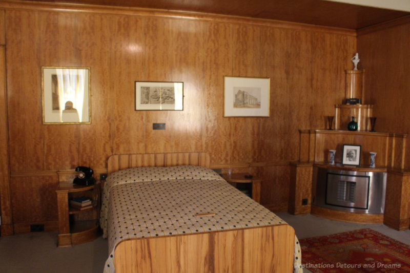 Art deco masculine bedroom with wood walls at Eltham Palace