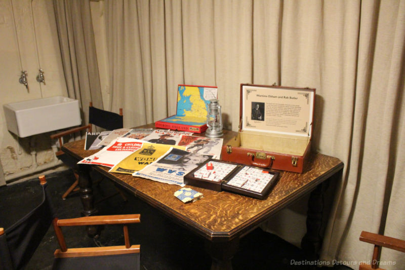 Table with display of posters, game, etc. from war time shelter at Eltham Palace