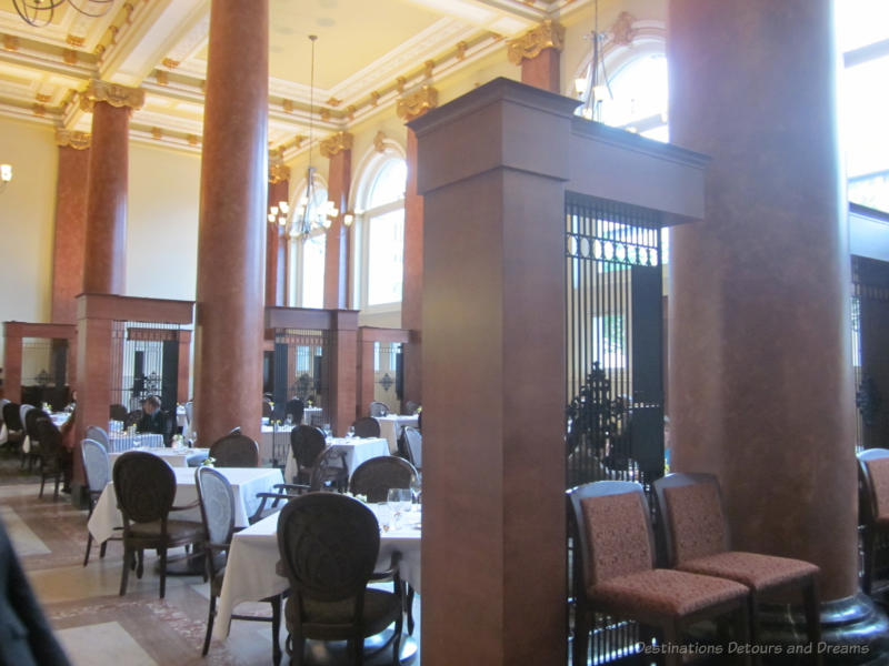 Elegant dining room of Janes Restaurant with marble pillars and floor