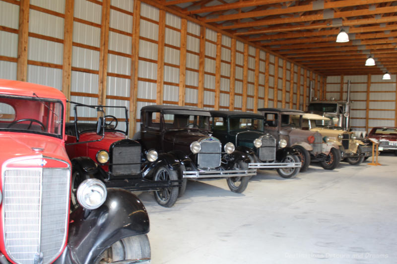 A collection of old cars on display at Mennonite Heritage Village