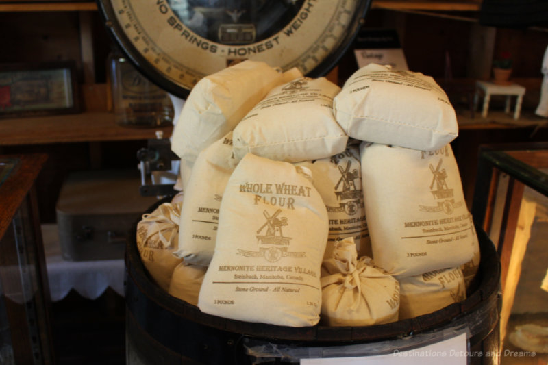 Small cloth bags of mill-ground flour for sale