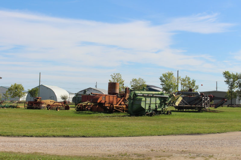 Old farm machinery in a field at the Mennonite Heritage Village