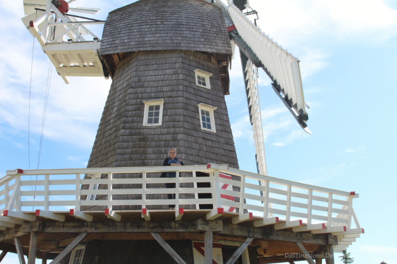 Women on second level balcony of wooden windmill