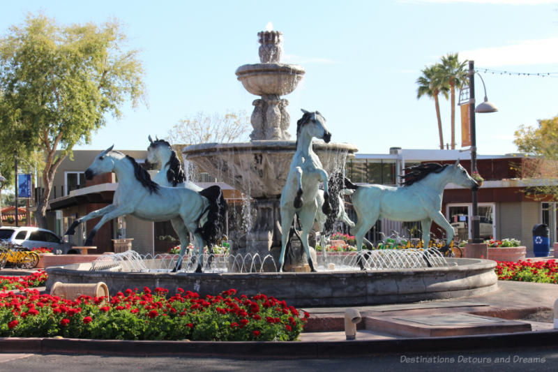 Bronze horse statue featuring 5 horses in a ring around a central fountain