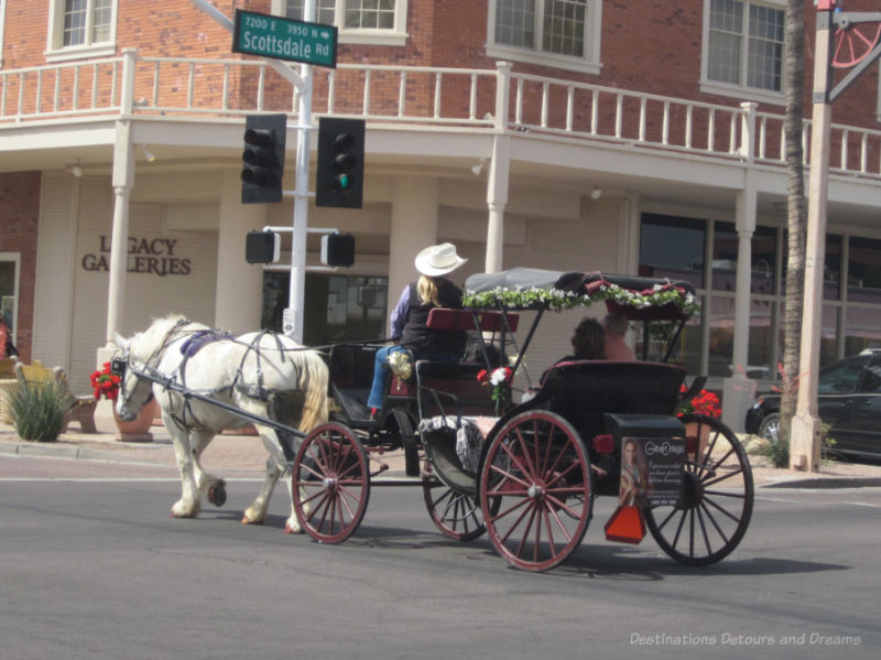 Horse and carriage driving through Old Town Scottsdale