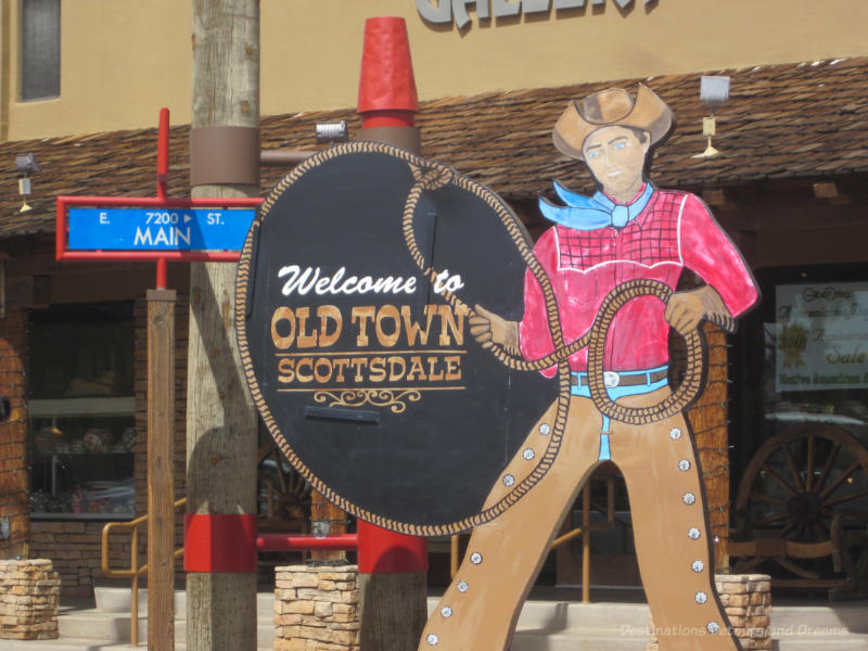 Sign of cowboy with lasso Welcome to Old Town Scottsdale sign