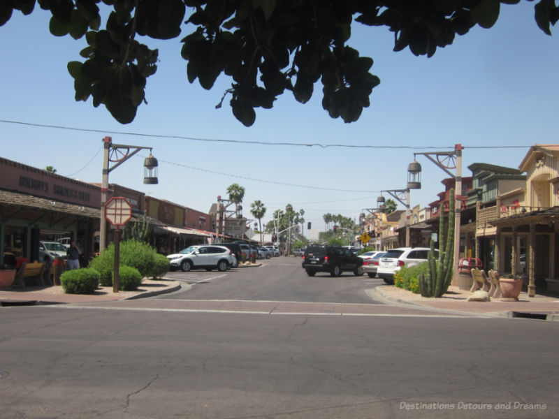 Wide street with rustic old-West style buildings on either side  in Old Town Scottsdale