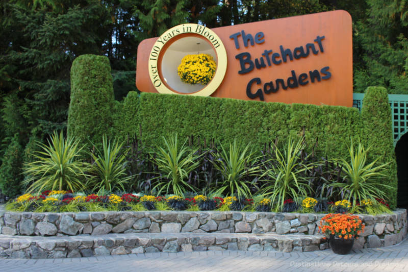 Sign and floral display at entrance to The Butchard Gardens