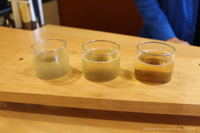 Three glasses of cider in a tasting flight at Ciderworks