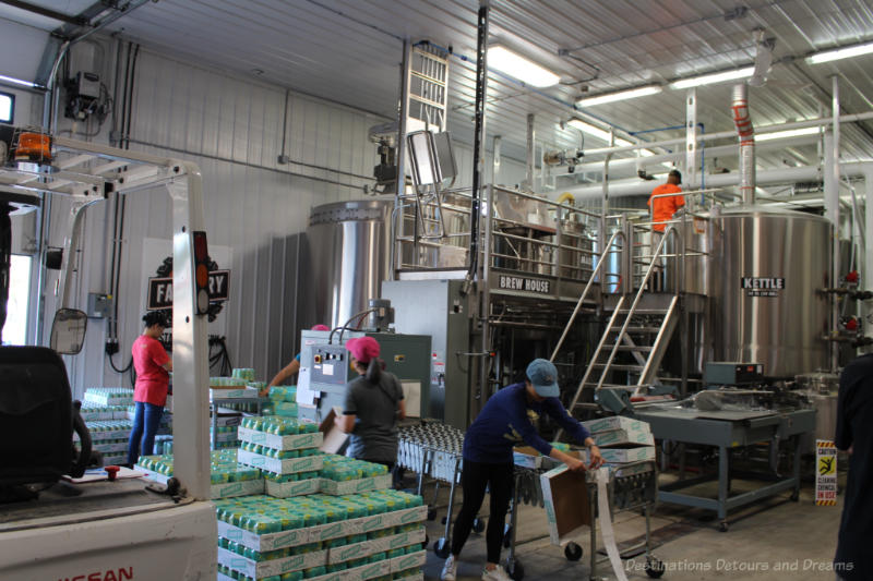 People working inside a brewery