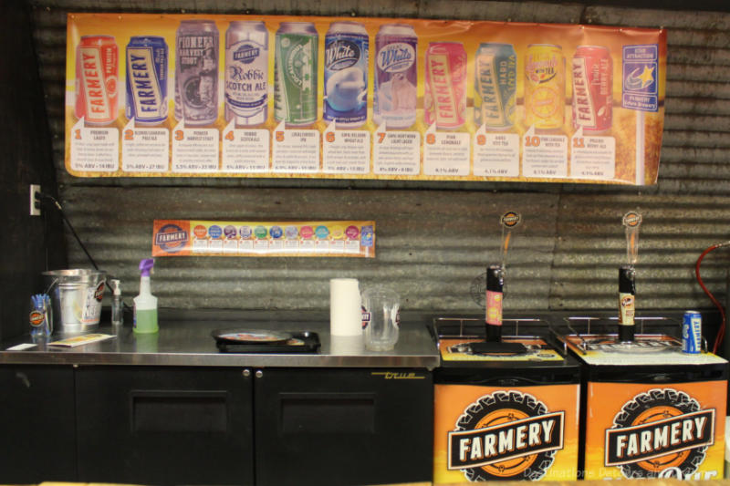 Sign with photos of beer available for tasting at Farmery Brewery