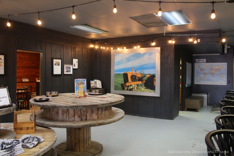 Rustic table and picture of tractor on wall at Farmery tasting room