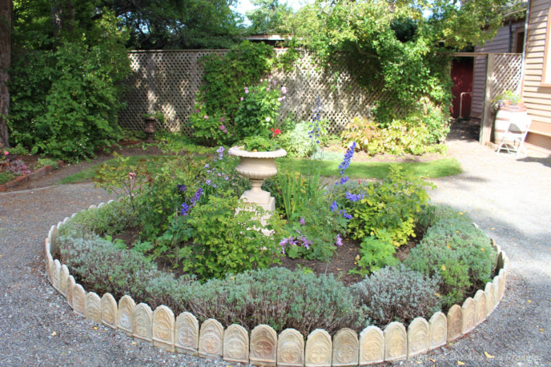 Circular garden edged with Gothic tiles