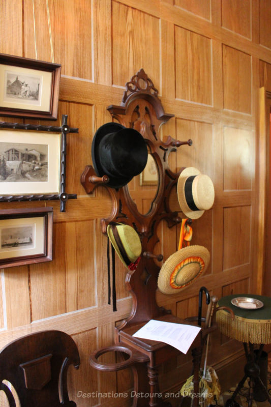 Hat rack in entry wall with wood-grained wallpaper