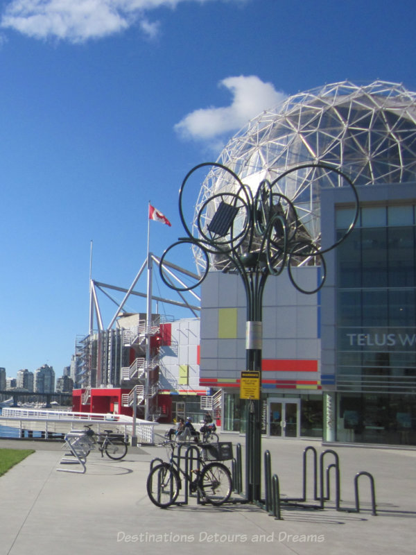 Metal tree-like sculpture that is also a bike rack at Vancouver Science Centre