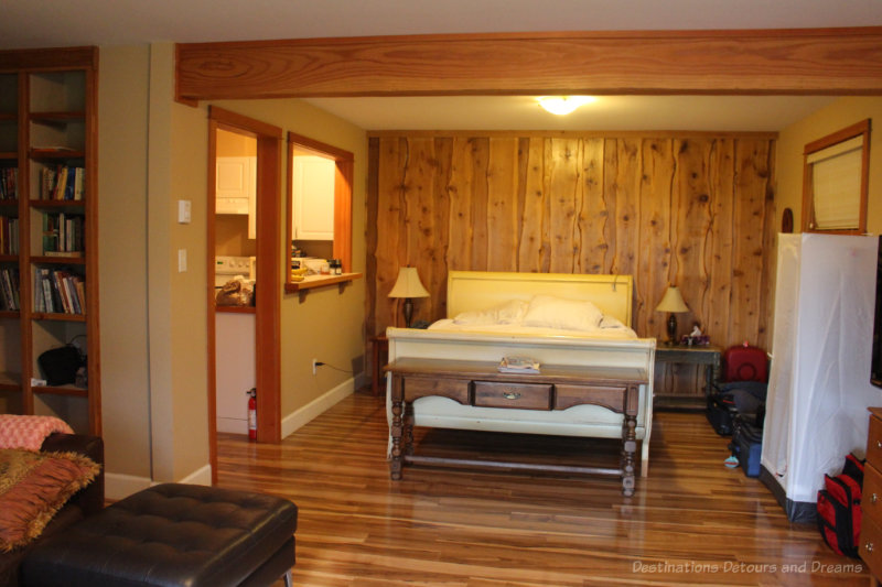 Studio suite with rustic wood feature wall and modern wood flooring
