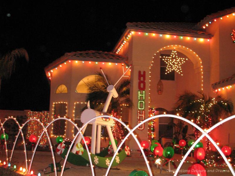 House lit up for Christmas with HoHoHo and a star