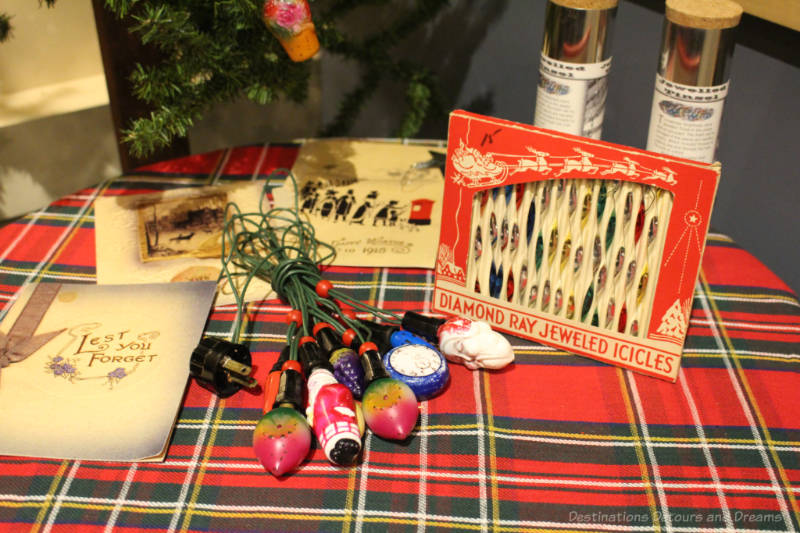 A table display of Christmas tree decorations from the 1920s and 1930s