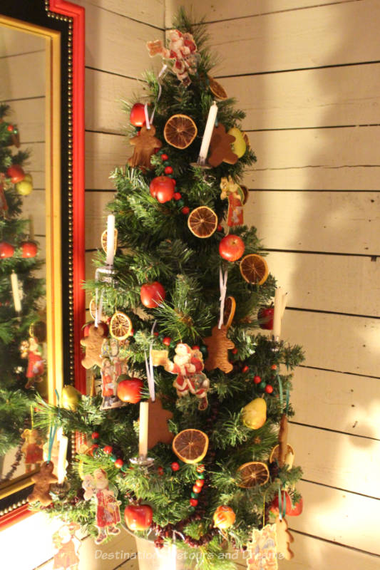 Victorian era Christmas tree with candles and dried fruit decorations