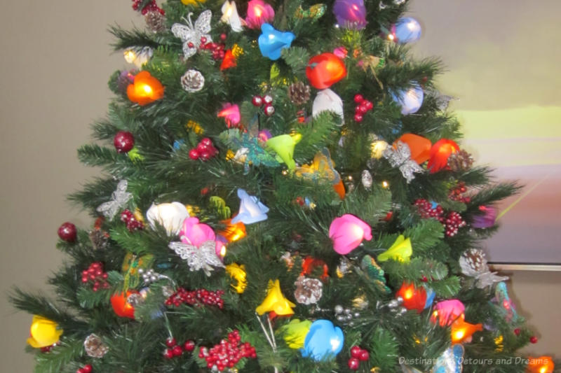 Various coloured lights and other decorations on a Christmas tree
