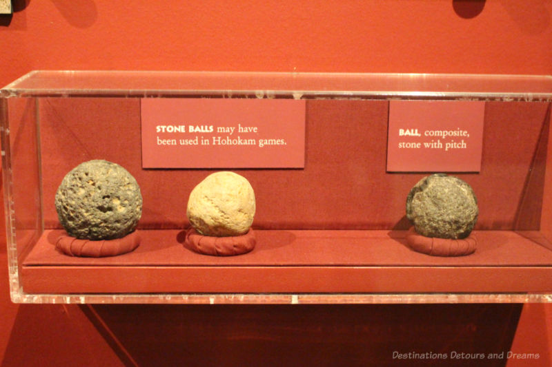 Display of three stone balls used in Hohokam games