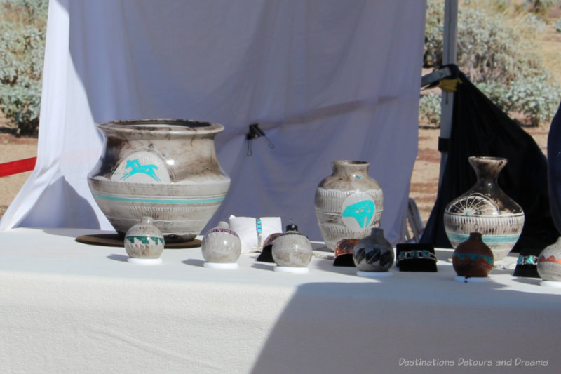 A collection of Indian pottery with turquoise decorations at an Indian market
