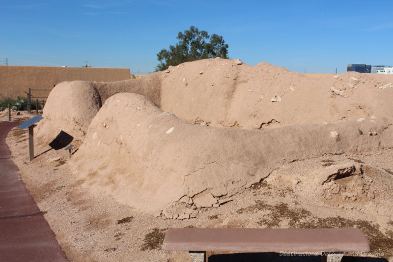 Rounded sandy walls of a building in Hohokam ruins