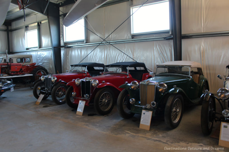 Vintage cars in a garage at The Roost
