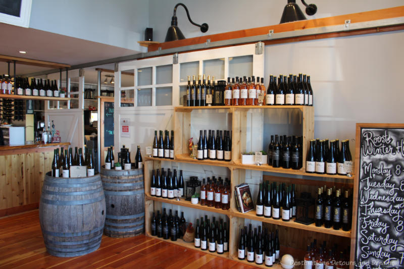 Wine for sale on wooden crate shelves at The Roost