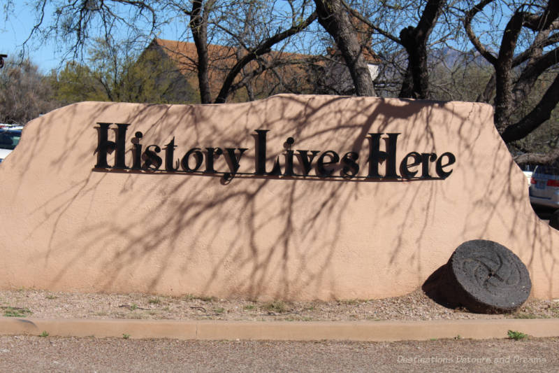 History Lives Here sign on rock at entrance to Tubac Presidio State Historic Park