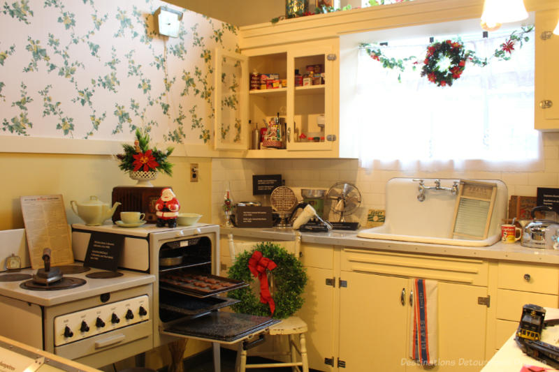 Recreated 1940s and 1950s era kitchen featuring electric range on display at Manitoba Electrical Museum
