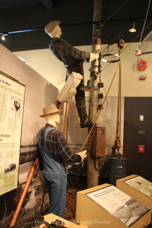 Display at Manitoba Electrical Museum showing lineman working on setting up electric wires on poles
