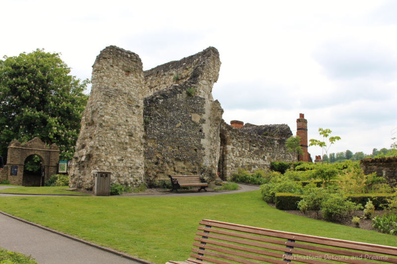 Ruins of Guildford Castle stone walls amid the park-like setting of the castle grounds