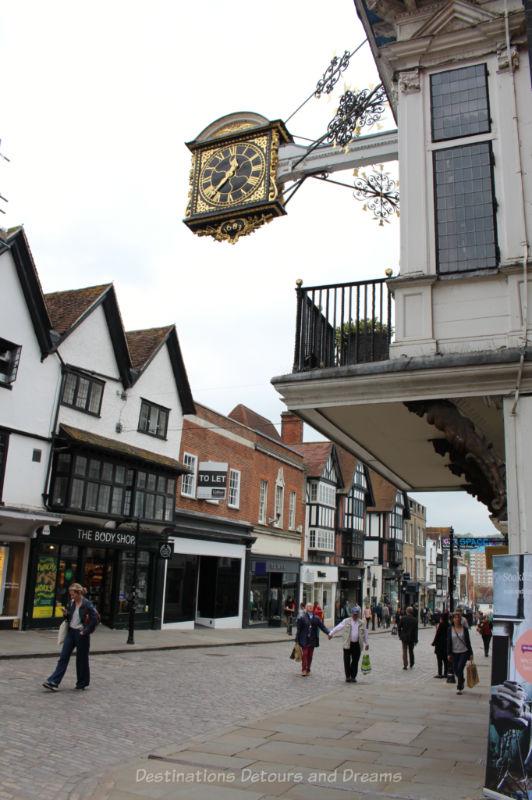 Gilt oak 17th century clock hanging over Guildford high street
