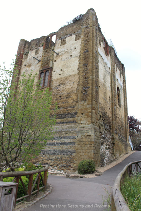 Looking up the hill to the stone walls of medieval Guildford Castle Tower from the back