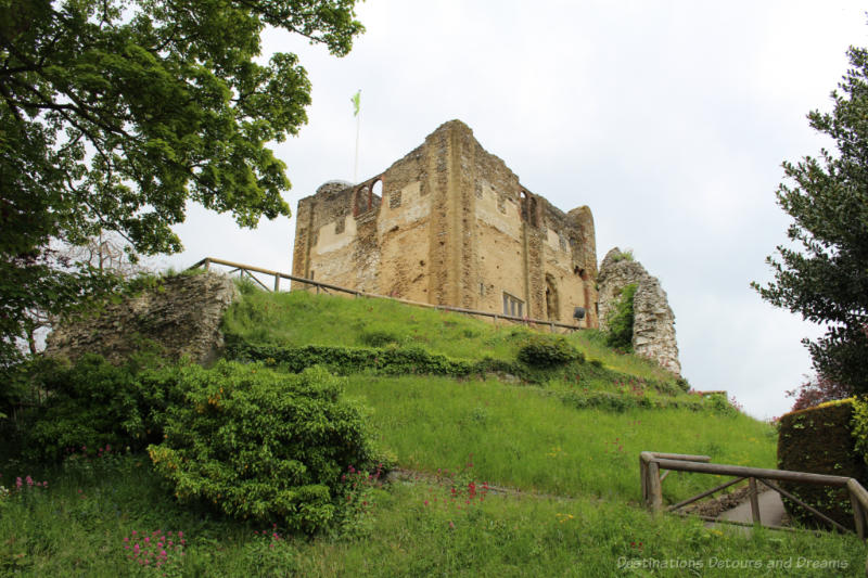 Guildford Castle stone Tower atop a grassy hill