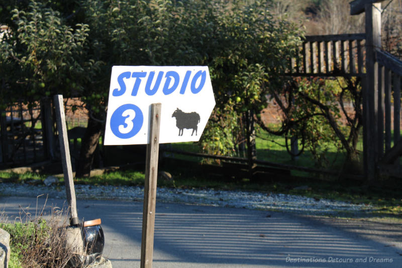 Studio 3 sign along side of road indicating a stop on a self-guided studio tour on Salt Spring Island